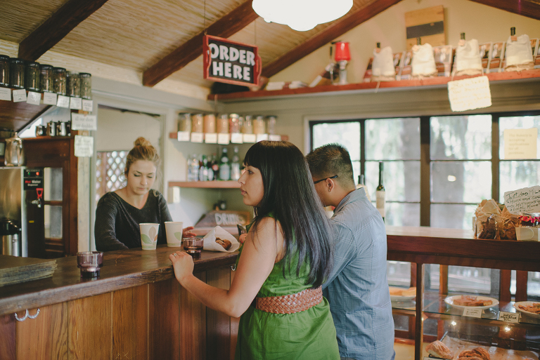 Big sur bakery engagement photo ordering drinks