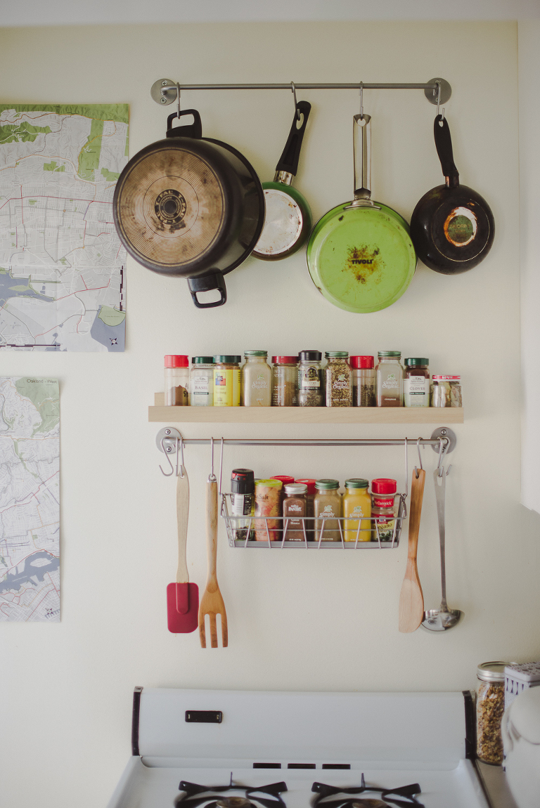 spices and pans hanging in kitchen
