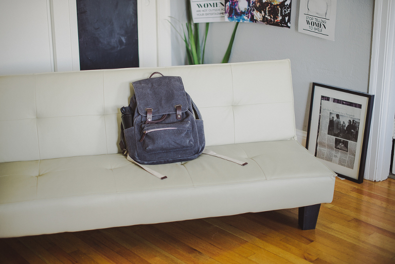 everlane backpack sitting on couch