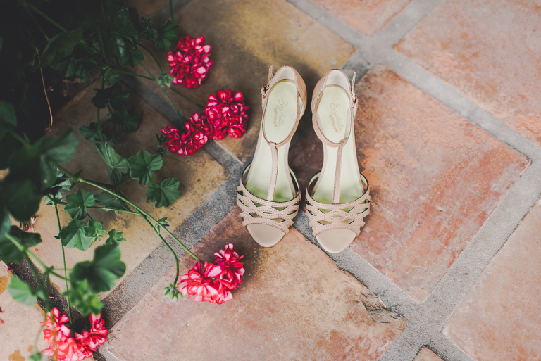 pink brides shoes near geranium plant
