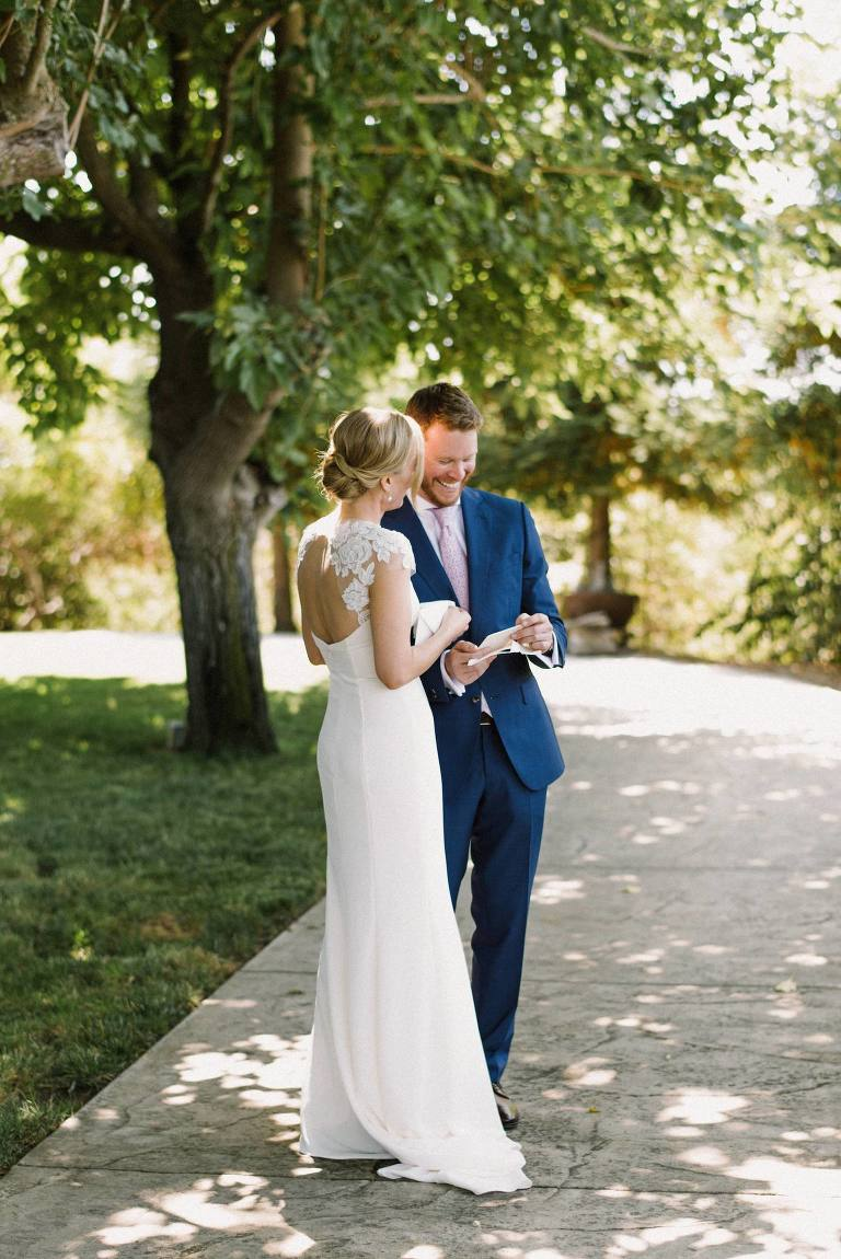 Couple reading letter to each other before ceremony