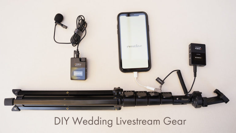 top down look at equipment to DIY livestream. Phone with eventlive logo, phone tripod stand, audio gear with mic and receiver.